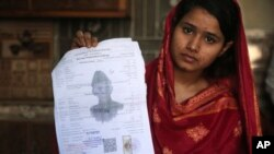 In this April 14, 2019 photo, Mahek Liaqat, who married a Chinese national, shows her marriage certificate in Gujranwala, Pakistan. Poor Pakistani Christian girls are being lured into marriages with Chinese men, whom they are told are Christian and wealth