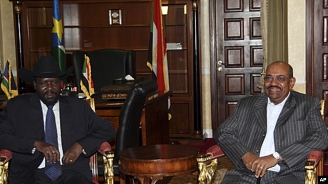 President of the Government of Southern Sudan, Salva Kiir Mayardit, left, with Sudan President Omar al-Bashir in Juba, South Sudan, April 2011.