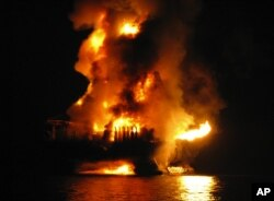 U.S. Coast Guard and other agencies respond to the 2010 Deepwater Horizon oil rig fire in the Gulf of Mexico. (Otto Candies/US Coast Guard Press)