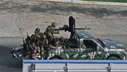 Unidentified troops in the city of Abidjan Friday