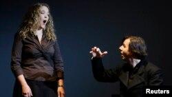 "FILE - Conductor Teodor Currentzis, right, accompanies U.S. opera singer Mardi Byers during premiere of Alban Berg opera ""Wozzek,"" Bolshoi theater, Moscow."