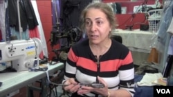 버지니아주 샬러츠빌에서 남편과 함께 '야디의 옷 수선 가게'를 운영하는 이란 출신 파르빈 자말레자.