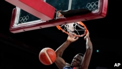 France's Moustapha Fall dunks during men's basketball preliminary round game against Iran at the 2020 Summer Olympics, July 31, 2021, in Saitama, Japan.