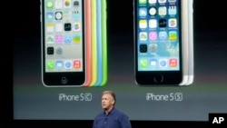 Phil Schiller, Apple's senior vice president of worldwide product marketing, introduces the new iPhone 5c and 5s in Cupertino, California, Sept. 10, 2013.