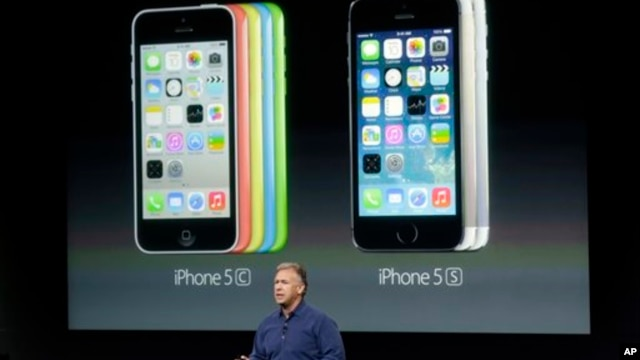 Phil Schiller, Apple's senior vice president of worldwide product marketing, speaks on stage during the introduction of the new iPhone 5c and 5s in Cupertino, California, Sept. 10, 2013.