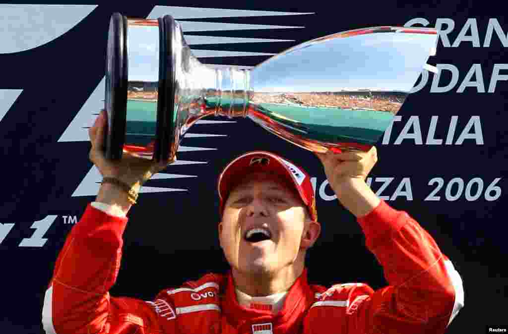 Michael Schumacher lifts the trophy on the podium after winning the Italian Grand Prix at the Monza race track, Sept. 10, 2006.