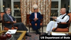 U.S. Secretary of State John Kerry, center, sits with candidates Abdullah Abdullah, left, and Ashraf Ghani. The U.S. helped negotiate a deal to audit the ballots and resolve the dispute.