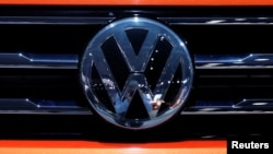FILE - The Volkswagen logo is seen on a vehicle in New York, March 29, 2018.