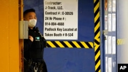 "An Asian American New York City Police officer patrols inside the ""7"" train station beneath a heavily trafficked section of Main Street in Flushing, a largely Asian American neighborhood, Tuesday, March 30, 2021, in the Queens borough of New York…"
