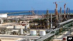 FILE - Oil and gas installations are found throughout Libya. This one, built by the Italian ENI group, is on the coast near Mellitah, Libya.