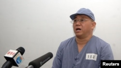 "FILE - Kenneth Bae, a Korean-American missionary who is serving a sentence in North Korea for ""hostile acts"" appears before reporters in Pyongyang in this undated photo released by North Korea's Central News Agency (KCNA) on January 20, 2014."
