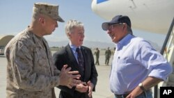 U.S. Secretary of Defense Leon Panetta, right, speaks with U.S. Ambassador Ryan Crocker, center, and General John Allen upon his arrival in Kabul, Afghanistan, June 7, 2012.