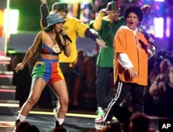 "FILE - Cardi B and Bruno Mars perform ""Finesse"" at the 60th annual Grammy Awards at Madison Square Garden in New York, Jan. 28, 2018."