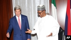 In this photo released by the Nigeria State House, U.S. Secretary of State John Kerry, left, talks to Nigeria's President Muhammadu Buhari, before their bilateral talks at the State House in Abuja, Nigeria, Tuesday Aug. 23, 2016.