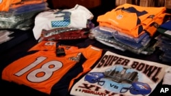 Seized counterfeit NFL merchandise is displayed before a news conference at the NFL Super Bowl XLVIII media center, Thursday, Jan. 30, 2014.