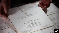 FILE - Invitations for Prince Harry and Meghan Markle's wedding in May, after they have been printed at the workshop of Barnard and Westwood in London, March 22, 2018.