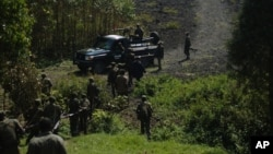 Congolese soldiers visit territory that was retaken from M23 rebels, Sept. 6, (AP Photo/Joseph Kay)