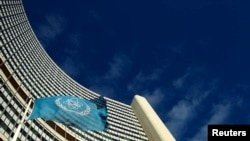 FILE - The flag of the International Atomic Energy Agency (IAEA) flies in front of its headquarters in Vienna.