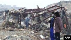 Preživeli u mestu Minamisanriku, severni Japan, 14. mart 2011.