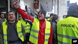 Police officers shout slogans as they protest against their pension fund's participation in the Greek bond swap in Athens March 7, 2012.