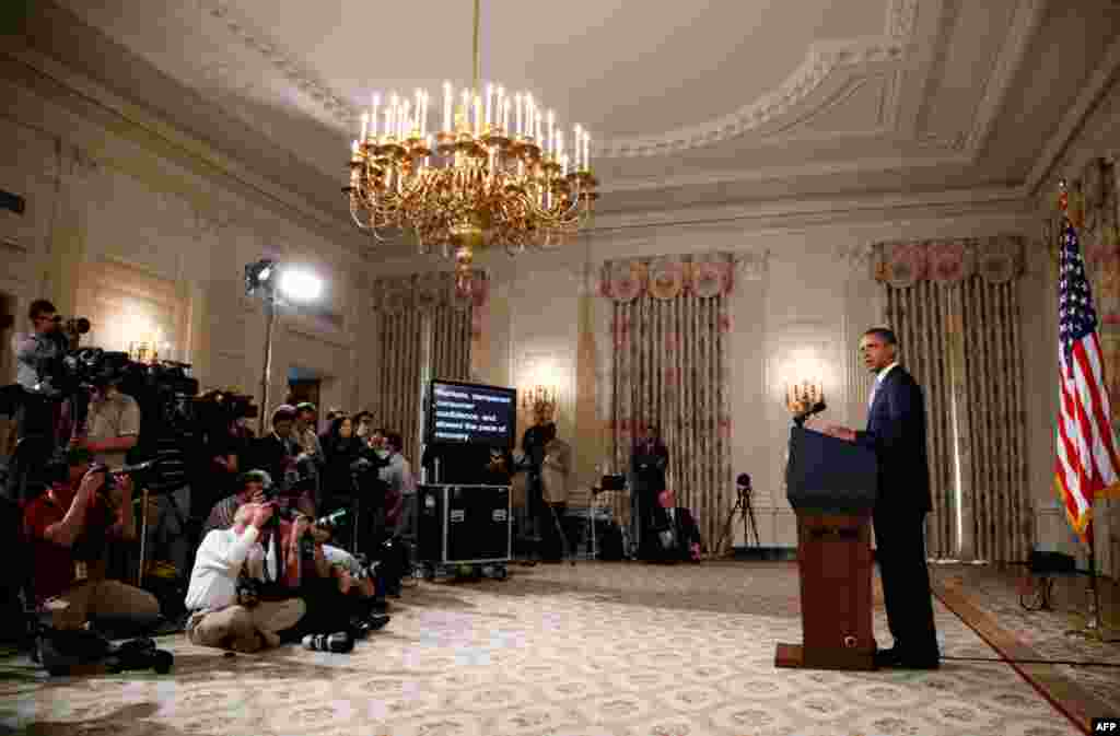August 8: U.S. President Barack Obama delivers a statement on the lowering of the U.S. credit rating and the Afghan helicopter crash in the State Dining Room of the White House. REUTERS/Jason Reed