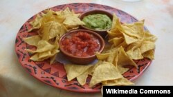 Researchers say Super Bowl parties, which often feature chips and dip, help spread the flu.