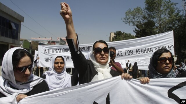 An Afghan protestor shouts slogans during a demonstration in support of female victims of abuse and violence in Kabul, Afghanistan, July 11, 2012.