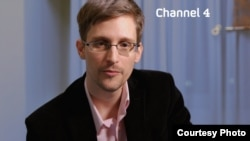 "FILE - Edward Snowden is seen delivering his ""Alternative Christmas Message"" on Britain's Channel 4. (Channel 4)"