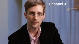 "Edward Snowden is seen delivering his ""Alternative Christmas Message"" on Britain's Channel 4. (Channel 4)"