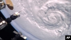 A photo taken from video and provided by NASA, Jan. 15, 2016, shows Hurricane Alex seen from the International Space Station.