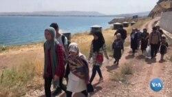 Tolibondan qochayotgan ayrım afg'onlar Turkiyaga bormoqda
