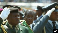 FILE - Zimbabwean President Robert Mugabe (C), surrounded by members of the military, is seen attending 25th anniversary Independence celebrations in Harare, Zimbabwe, April 18, 2005.