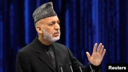 FILE - Afghan President Hamid Karzai speaks during the opening of the Loya Jirga, in Kabul, Nov. 21, 2013.