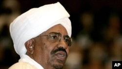 Sudanese President Omar al-Bashir delivers a speech during his swearing-in ceremony at the parliament in Khartoum, 27 May 2010