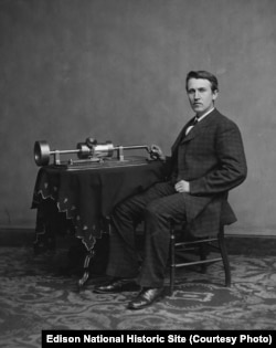 This photograph shows a young Edison with his phonograph (2nd model), taken in renowned Civil War photographer Mathew Brady's Washington, DC studio in April 1878.