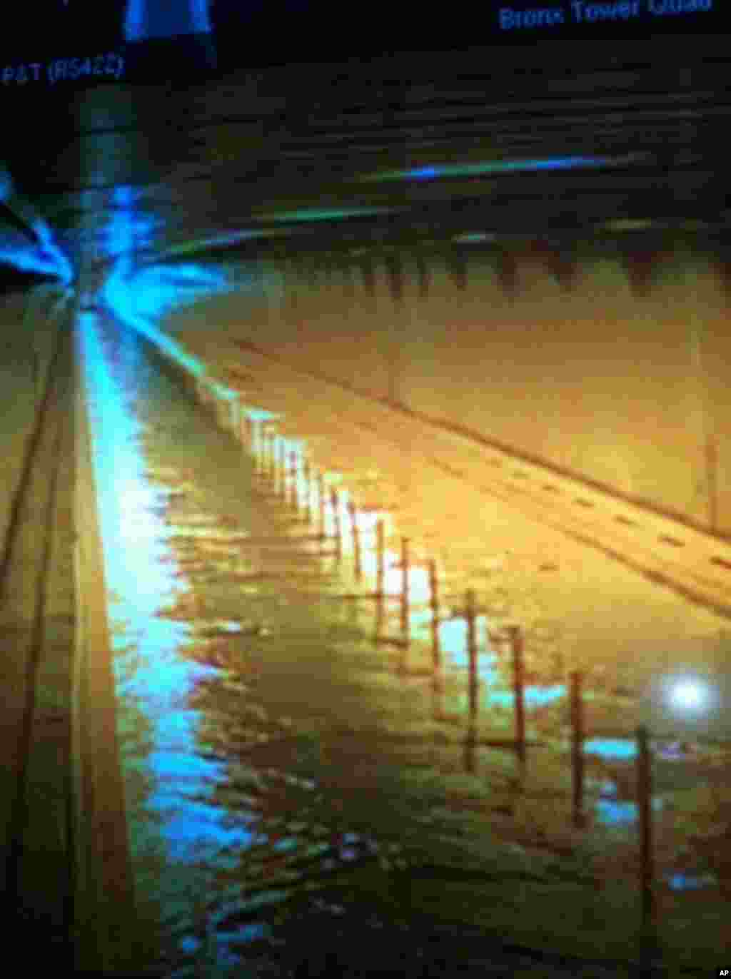 This photo provided by MTA Bridges and Tunnels shows floodwaters from Sandy entering the Hugh L. Carey Tunnel (former Brooklyn-Battery Tunnel), which was closed on Monday, Oct. 29, 2012. (AP Photo/ MTA Bridges and Tunnels)