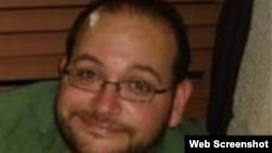 FILE - Jason Rezaian, who was born in California and holds dual U.S. and Iranian citizenship, was arrested with his Iranian wife Yeganeh Salehi at their home on July 22, 2014.