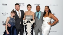 "Cast members, from left, Joey King, Channing Tatum, Maggie Gyllenhaal, Jamie Foxx and Garcelle Beauvais attend the ""White House Down"" premiere at the Ziegfeld Theatre, June 25, 2013 in New York."