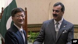 CChinese Public Security Minister Meng Jianzhu, left, shakes hands with Pakistan's Prime Minister Yusuf Raza Gilani in Islamabad, Pakistan. China's top security official is visiting Pakistan for talks focusing on increased cooperation against Chinese mili