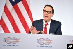 FILE - U.S. Treasury Secretary Steven Mnuchin speaks at a news conference during the G20 finance ministers meeting in Baden-Baden, southern Germany, March 17, 2017.