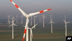 FILE - Wind turbines produce green energy in Nauen near Berlin, Germany.
