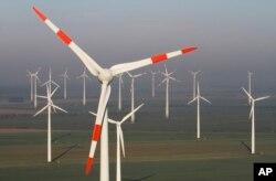 FILE - Wind turbines produce green energy in Nauen near Berlin, Germany.