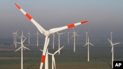 Wind turbines produce green energy in Nauen near Berlin, Germany.