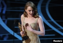 Best Actress winner Emma Stone accepts her award for La La Land.