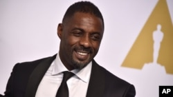 Idris Elba poses in the press room at the Oscars on Sunday, Feb. 22, 2015, at the Dolby Theatre in Los Angeles.