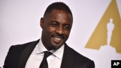 FILE - Actor Idris Elba, pictured at the Oscars in Los Angeles on Feb. 22, 2015, is one of 700 people invited to join the voting board of the Academy of Motion Picture Arts and Sciences.