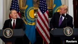 U.S. President Donald Trump and Kazakhstan President Nursultan Nazarbayev speak in the Roosevelt Room of the White House in Washington, Jan. 16, 2018.