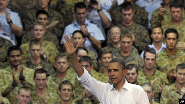 U.S. President Barack Obama waves to the troops after speaking at the Royal Army Air Force Base in Darwin, Australia, November 17, 2011.