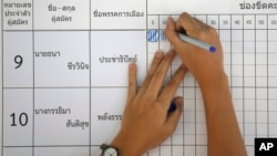 FILE - An election officer counts votes at a polling station in Bangkok, Thailand, March 24, 2019.