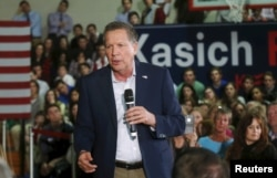 Republican U.S. presidential candidate John Kasich addresses supporters during a campaign stop in the gymnasium of University Liggett School in Grosse Pointe Woods, Mich., March 7, 2016.